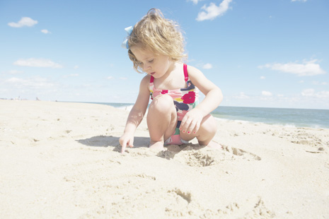 Clara playing on beach