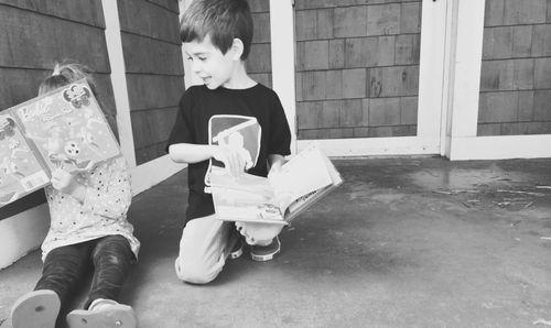Reading on boardwalk
