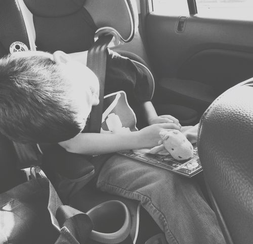 Asleep in car with book